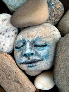 Painting this on rocks and hiding among other rocks would be fun.  Can you imagine walking around someone's garden and coming across this?