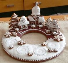 Incredibly beautiful gingerbread town with candles. An Advent wreath gingerbread… Christmas Gingerbread House, Christmas Sweets, Christmas Cooking, Noel Christmas, Christmas Goodies, Gingerbread Cookies, Christmas Decorations, Xmas, Gingerbread Houses