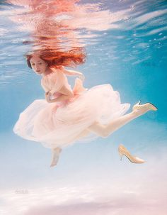 Elena Kalis is underwater photographer based in Bahamas. She is extremely talented artsy soul and I love her work so much! Welcome to amazing, underwater fantasy world. Under The Water, Underwater Photos, Underwater Photography, Elena Kalis, Photos Sous-marines, Photographs, Book 15 Anos, Chesire Cat, Robert Frank