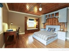 Hardwood ceiling and complementary #headboard, built-in shelving and a reading nook!