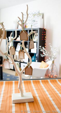 Thankful Tree.  Going to use branches & make a table centerpiece using this idea.  Then have blank tags for everyone at Thanksgiving dinner to write something they are thankful for.  Keep adding to it each Thanksgiving.