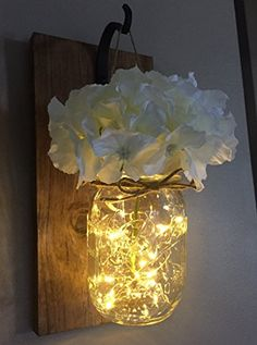 Rustic Hanging Mason Jar Sconces with LED Fairy Lights, Mason Jar Lights, Wrought Iron Hooks, Silk Hydrangea Flower, LED Strip Lights with Batteries Included, Rustic Home Decor (Set of 2)  Price: (as of  - Details)   Handmade Rustic Hanging Mason Jars with Beautiful Ivory Hydrangea flower...