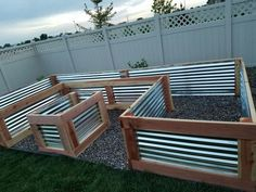 Beautiful custom raised garden bed my husband and I just finished. It turned out perfect! Used redwood and galvanized sheet metal. Measures 4 ft W x 8 ft x 16 ft x 27 in H. - Fresh Gardening Ideas #raisedbedslandscaping