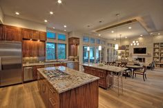 Dual-island contemporary Kitchen, open to breakfast room & family room, Austin, Texas