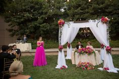 Hot pink, orange and green sweetheart table decor at a Disneyland Hotel wedding on the Magic Kingdom Lawn