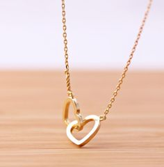 Crossed heart, never apart in gold color
