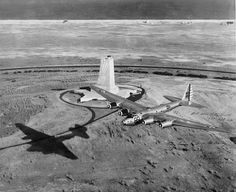 A B-15 flying over the granite memorial to the Wright Brothers' first flight at Kitty Hawk, North Carolina, 1939