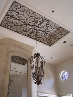 The ornamental ceiling wrought iron insert looks like it is made of iron but it is actually custom made from a composite wood material - faux iron. Ceiling Decor, Ceiling Design, Ceiling Lighting, Ceiling Ideas, Foyer Lighting, Ceiling Detail, Unique Lighting, Lighting Ideas, Ugly Kitchen