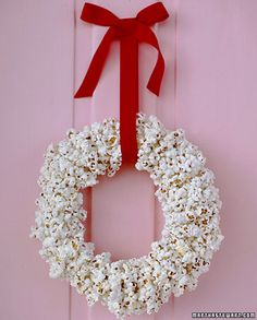 // Popcorn garlands are nothing new, but this hand-strung wreath brings the idea full circle. Leftovers offer a welcome excuse for a holiday movie marathon.
