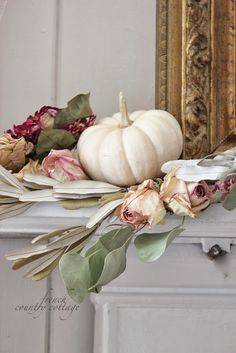 Beautiful Fall Mantal :: Dried florals are mixed with old brassy golds and white pumpkins