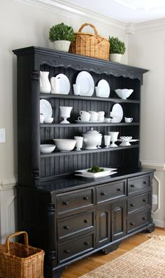 Decorate farm house kitchen hutch with white dishes.