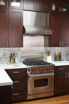 """Modern and clean with cherry. - Love """"Shaker"""" cabinets and light counters for basement."""