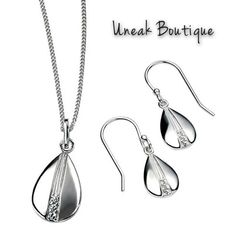 Teardrop Silver Pendant with Cubic Zirconia Center. Dainty silver pendant in a small teardrop shape set with a line of three sparkling Cubic Zirconia down the center of the pendant. This lovely silver pendant by Elements Silver is so pretty and perfect for a special occasion or as a gift.  http://www.uneakboutique.co.uk/collections/pendants/products/teardrop-silver-pendant-with-cubic-zirconia-center