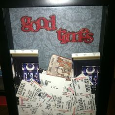 Shadow box with scrapbook backing filled with old ticket stubs