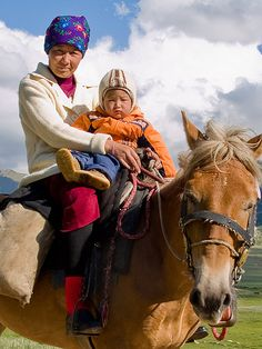 Mother and son, Kyrgyzstan. Photo: Evgeni Zotov, via Flickr