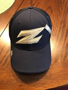 "Akron on the back of the hat in gold. Adidas logo is on the side in white.  Football on front of hat. ""Z"" logois on front ... 2c67e914438c"