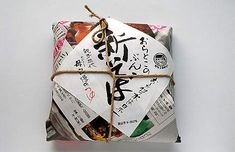 Cord and label put the final touch to this package of soba noodles wrapped in plain newspaper.
