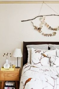 newspaper, wood, wall hanging. tree bedspread. idea for g wall