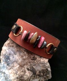 Bohemian leather cuff bracelet from vintage upcycled leather belts. I cut and shape the leather, add hardware like grommets, rivets and very strong snaps.    The variety and wear of each leather will vary from cuff to cuff. Some are extremely worn in, soft and worn leathers and some are