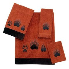 This Luxurious towel set features embroidered wolf, bear, and moose tracks