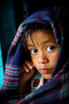 nepalese girl watching the rain