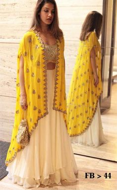 60 GM Georgette Party Wear Lehenga Choli In Cream and Yellow Colour Buy Best price latest designer Georgette Party Wear Lehenga Choli In Cream and Yellow Colour online in india Cash on Delivery Available! Indian Fashion Dresses, Dress Indian Style, Indian Gowns, Indian Designer Outfits, Indian Attire, Pakistani Dresses, Indian Wear, Indian Diy, Indian Party Wear