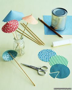Festive Drink Umbrellas - Martha Stewart - We plan to make miniature Kaylee parasols using this idea