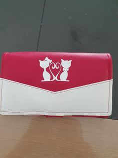 Compangon Complice en simili rouge et blanc cousu par Gwen - Patron Sacôtin