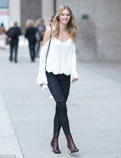 British beauty! Megan Williams, 22, went with a casual cool vibe in white off-the-shoulder sweater and chocolate brown ankle boots