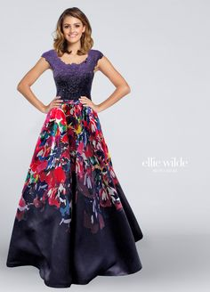 The Ellie Wilde EW117171 prom dress features a lace bodice with a scoop neckline and cap sleeves, over a full A-line skirt in signature abstract print Mikado. A frilly trim adorns all edges of the fitted top, jazzed up with heat-set stones. The full-length skirt begins on a slim set-in waistband. Available in sizes 0 to 24.