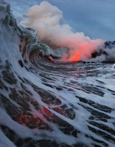 A picture of lava flowing into the ocean. Fire and water involved in Mephisto waltz. They can and do exist, at one time together, in one place! Ain't the universe just great!
