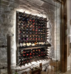 modern wine cellar with stone wall and LED back-lighting