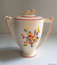 "Canonsburg Potteries ""Westchester"" coffee pot. Founded in 1900, this Pennsylvania company produced many lines, often featuring decaled floral designs, until it closed in the 1970s."