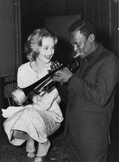 """Jeanne Moreau and Miles Davis during the recording of the music for Louis Malle's film """"Elevator to the Gallows,"""" in December, Paris, 1957."""