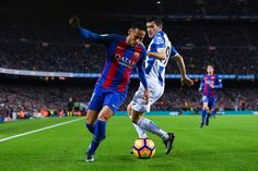 Neymar Jr. of FC Barcelona competes for the ball with Aaron Martin of RCD Espanyol during the La Liga match between FC Barcelona and RCD Espanyol at the Camp Nou stadium on December 18, 2016 in Barcelona, Catalonia.