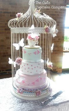 Butterflies / cage around cake -- maybe add birds? Google Image Result for http://media.carddit.com/a/TCTWYWb3X.jpg