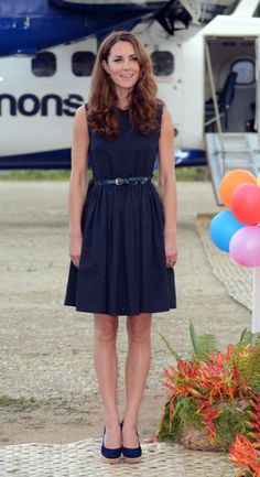 <p>Kate donned a midnight blue dress by Mulberry for another day in the Solomon Islands. She accessorised with navy cork wedges by Stuart Weitzman. </p><p><i>[Photo: PA]</i></p>