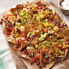 Triple Pepper Nachos- These vegetarian nachos are the perfect addition to any fiesta. Black beans, roasted peppers, salsa and reduced-fat cheese make this the best loaded nachos recipe. Only 200 calories per serving, these healthy nachos are guilt free. Healthy Nachos, Vegetarian Nachos, Veggie Nachos, Game Day Snacks, Game Day Food, Appetizer Recipes, Appetizers, Homemade Nachos, Mexican Food Recipes