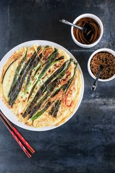 Korean Pajeon (seafood and green onion pancakes) paired with Korean sweet tangy soy dipping sauce | MyKoreanKitchen.com