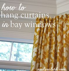 Hanging Curtains on Angled Windows @emilyaclark