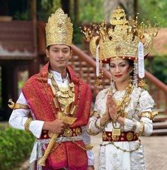 Wedding costumes from Lampung Province, Southern Sumatra, Indonesia.
