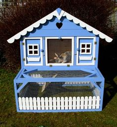 My style of rabbit hutch but it would have to be White and Green to match the house and barn :)