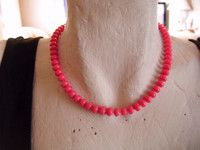 """goldtone clasp bright pink plastic bead necklace 16""""long in good condition"""