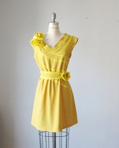 I love a sunny, yellow dress. This one is both romantic and vintage-looking. AtelierSignature on etsy.