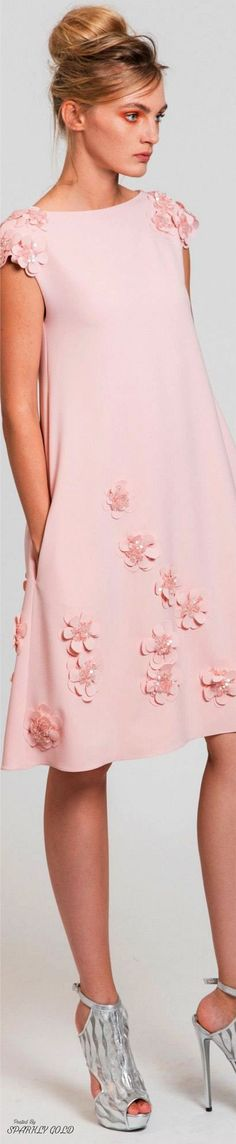 like the embellishment on shoulders and dress; a touch of something covering the top of arm rather  than sleeveless