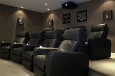 A contemporary Home Theater room installed by Maven, a home cinema specialist in UK. Using a Cineversum Blackwing video-projector.
