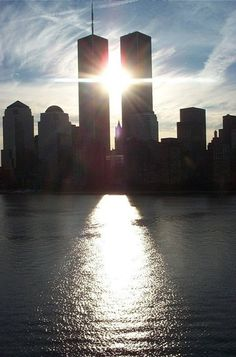 Twin towers with a beautiful sunlit cross