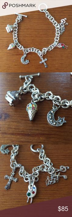 Silver Charm Bracelet 🎹 🍦 🌙 🎨 🎼 🎶 Silver charm bracelet with 6 charms: piano, jeweled ice cream cone, jeweled moon & star, cross, artist palette, music notes.  Chain and charm bought from Macy's fine jewelry counter. Some patina on chain and charms (see pictures). Macy's Jewelry Bracelets