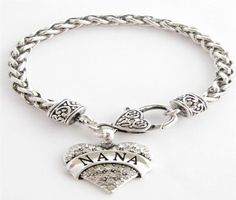 Sports Accessory Store is proud to bring you this Beautiful, Fashionable, and Elegant Silver Plated Lobster Claw Chain Bracelet. Bracelet measures approximately 7.5 inches in diameter and features a stunning Clear Crystal Silver Plated Nana Charm. Complete the Collection, make sure to check out the matching Earrings, Necklace, and Stretch Ring.      7.5 Diameter Silver Plated Chain Bracelet  Lobster Claw Clasp  Silver Plated Charm  Clear Crystals  Made in the USA