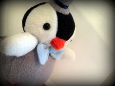 Handmade Percy the penguin plushBrilliant for those chilly winter nights too cuddle up too!Comes with a cute Bow tie and top hat - (The colors can be customized)Dont see a color you want or want to add something